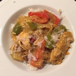 Slow Cooker Coconut Curry Chicken Recipe - Morsels of chicken breast are slow-cooked in a creamy coconut curry with potatoes and red bell pepper. Raisins and flaked coconut add texture and sweetness to this rich dish.