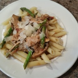 Marsala Cream Chicken with Asparagus Recipe - Using a deli-roasted chicken from your local grocery store speeds the prep time on this pasta dish with a creamy Marsala wine sauce.