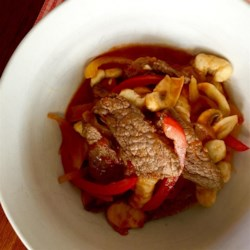 Aussie Beef and Peppers with Gnocchi Recipe - Gnocchi and tender beef strips are tossed with tomatoes, bell peppers, and mushrooms for a classic meal from Down Under.