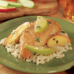 Apple Cider Chicken with Wild Rice Recipe - Apple slices, cider, thyme and mustard bring incredible, rich flavors to this easy chicken dinner. Wild or brown rice makes a perfect side dish.