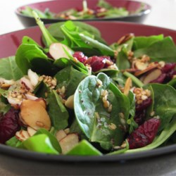 Jamie's Cranberry Spinach Salad Recipe and Video - Spinach, toasted almonds, and dried cranberries are tossed with a sweet and tangy, homemade dressing creating a crowd-pleasing spinach salad.