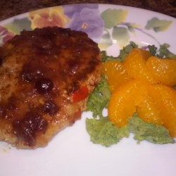 Turkey Salisbury Steak with Cranberry-Orange Gravy Recipe - The cranberry-orange 'gravy' in this recipes is a natural topping for these non-traditional Salisbury steaks made with ground turkey.