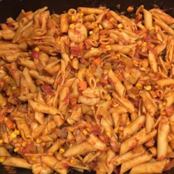 Prawn Pasta Recipe - Dry cider adds a fresh sweetness to a simmer of garlic, onions, bell peppers, celery and tomatoes. Cook penne in the sauce to soak up the flavor, then add prawns for a scant 5 minutes to finish the dish.