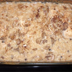 Baked Chicken on Rice Recipe - A creamy mushroom sauce cloaks tender baked chicken breasts in this easily prepared entree.