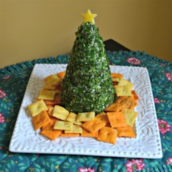 Cream Cheese, Havarti, and Parmesan Herbed Christmas Tree Recipe - Shape a cheese ball into a tree and coat it with fresh basil and parsley for a festive Christmas tree appetizer for your holiday party.