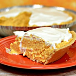 No-Bake Pumpkin Cheesecake Pie Recipe - Use prepared pumpkin pie filling, cream cheese, whipped dessert topping, and a prepared pie crust to make this no-bake pumpkin cheesecake pie.