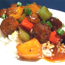 Waikiki Meatballs Recipe - Beef meatballs flavored with ground ginger, simmered in a sweet pineapple sauce.
