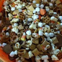 Halloween Party Mix Recipe - A new twist on party snack mix includes pumpkin seeds, goldfish crackers, and pretzel sticks for a Halloween-inspired treat.