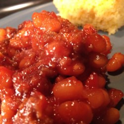 Ranch Beans with Beef Recipe - This baked bean recipe starts with browned ground beef and cans of pork and beans to get to a deliciously meaty side dish.