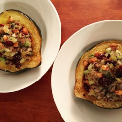 Wild Rice Stuffed Acorn Squash  Recipe - Acorn squash are stuffed with a mixture of cornbread, mushrooms, and wild rice flavored with sage to make an impressive vegetarian main course or side dish that's fit for a special occasion or holiday meal.