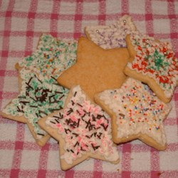 Simple Sugar Cookies Recipe - One of the simplest sugar cookies ever!  When baked, they are delicious and it's hard to keep them in the cookie jar for long...because everyone eats them too quickly.