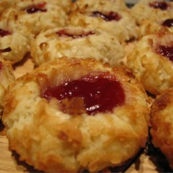 Thumbprint Cookies III Recipe - Like a butter cookie rolled in nuts with jam in the center. I make these every Christmas to give to relatives and friends. They all love this cookie!  For even more flavorful cookies, try using almond extract instead of the vanilla.