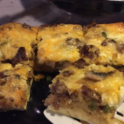 Best Breakfast Casserole Recipe - Breakfast casserole, made with sausage, crescent rolls, eggs, and Cheddar cheese, is always a welcome treat on holiday mornings.