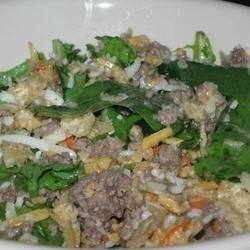 Italian Taco Salad Recipe - Browned ground beef is tossed with two kinds of cheese, crushed tortilla chips, and mixed salad greens, and topped with zesty Italian dressing.