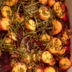 Purple Beet, Carrot, and Onion Medley Recipe - Purple beets, purple carrots, and red onion are roasted together creating a colorful vegetable trio that complement each other quite nicely.