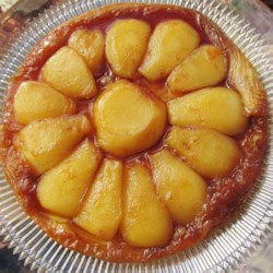 Maple-Pear Tarte Tatin Recipe - Pears poached in a maple caramel sauce then baked with a traditional puff pastry crust make a simple yet elegant dessert.
