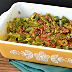Cheesy Green Beans Recipe - Cheese and bacon liven up plain green beans. This dish can be served immediately after preparing, but I often refrigerate it overnight to let the flavors blend together, then reheat it  in a 350 degrees F (175 degrees C) oven until heated through.