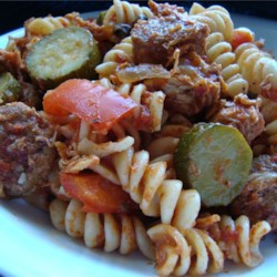Chicken, Sausage and Zucchini Pasta Recipe - Savory sausages and tender cubes of chicken leap into a saute pan with onion, garlic, bell peppers, tomatoes, mushrooms and zucchini. Toss with hot pasta and serve with a sprinkling of grated Parmesan, if you wish.