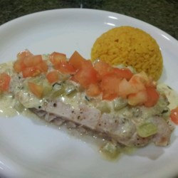 Poached Fish with Cucumbers Recipe - White fish is poached in wine and served with cucumbers cooked in whipping cream seasoned with mild mustard and tarragon.