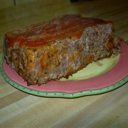 Italian Style Meatloaf II Recipe - Sauteed carrots and onions are added to this garlic-seasoned meatloaf. A simple tomato sauce is recommended to serve over it.