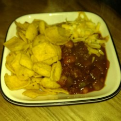 Fritos(R) Pie Recipe - Fritos(R) pie made with a layer of chips, beans and ground beef in a tomato sauce, and Cheddar cheese is a quick and easy dinner that is easy on the budget too!