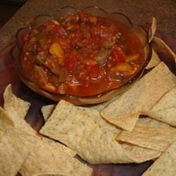 Eggplant Salsa and Homemade Pita Chips Recipe - I was in the produce aisle admiring the beautiful eggplants and I kinda said out loud 'hmmm... wonder what I could do with those?' and a woman answered, 'I always make salsa!'  SALSA??? So I figured I give it a shot.. and scribbled down her recipe!  YUM!