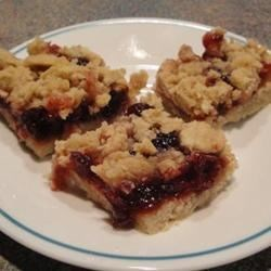 Cranberry Squares Recipe - These squares are very yummy. Try different fruits or jams to change the flavour. Note, you may replace up to half of the flour with whole wheat flour.