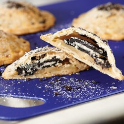 OREO & Apple Hand Pies Recipe - These fun-to-make individual OREO & Apple Hand Pies are the perfect twist to the traditional holiday dessert!