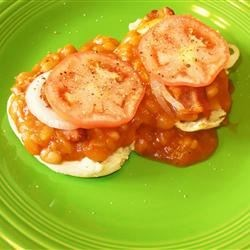Baked Bean Sandwiches Recipe - English muffin halves are topped with maple-cured baked beans, onion, tomato, cheese, and bacon. A delicious family favorite!