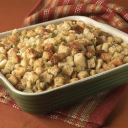 Classic Herb Stuffing Recipe - Make this savory stuffing, featuring poultry seasoning and thyme, a holiday tradition at your house. The oven-baked stuffing is the perfect complement to roasted turkey or turkey breast.