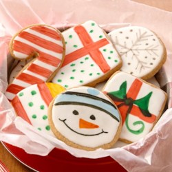 Holiday Painted Cookies Recipe - Make a quick and easy glaze for cookies by warming canned white frosting in the microwave. Then paint colorful designs on the cookie shapes using Flavor Paints––a fragrant mix of vanilla or lemon extract and food color.