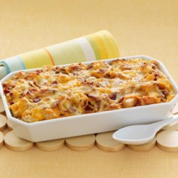 Cheesy Bacon and Egg Brunch Casserole Recipe - This one-dish brunch casserole is ideal for a crowd. Add a fruit salad and you can sit back and enjoy your company.