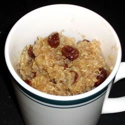 Quinoa Pudding Recipe - Tender quinoa is simmered with apple juice, raisins, and lemon juice and spiced with cinnamon and vanilla and served warm.
