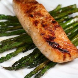 Soy-Honey Glazed Salmon with Asparagus Recipe - Salmon and asparagus are glazed with honey and soy sauce in this quick and easy salmon recipe that is ready in 20 minutes.