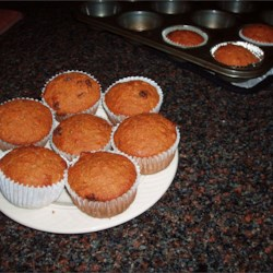 Carrot Muffins Recipe - There are lots and lots of good things in these pretty muffins. Besides carrots, there 's molasses and eggs and allspice. As well as brown sugar, cinnamon and whole wheat flour. No wonder they are soooooooo tasty. Makes 24 muffins.