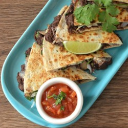 Mushroom and Black Bean Quesadillas Recipe - Mushroom and black bean quesadillas made on whole wheat tortillas are vegetarian, quick and easy, and a healthy dinner for the whole family.