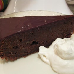 Hungarian Chestnut Cake Recipe - This flourless chocolate cake is made with pureed chestnuts, bittersweet chocolate, and rum. Topped with a rich chocolate ganache and served with rum whipped cream, it's a perfect dessert for special occasions.