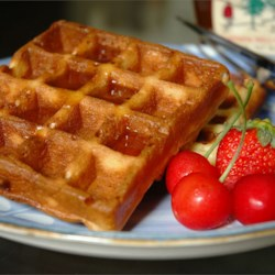 Belgian Waffles Recipe - The yeast in these eggy waffles makes for exceptionally deep pockets, perfect for capturing melting butter and syrups.
