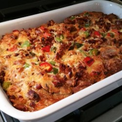 Most Excellent Breakfast Casserole Recipe - This hearty and flavorful casserole is made with sausage, bacon, eggs, bread slices, and two kinds of cheese.