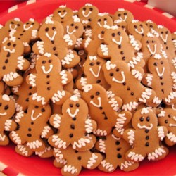 Gingerbread Boys And Girls Recipe - These cookies are formed by cookie cutters.  By using a toothpick to make a hole in the top of the cookie, you can hang them on the tree.  You can also make paint out of egg yolks, and food coloring to make them more colorful--use as much food coloring as needed to create desired hue.  My girls and I would spend hours making these cookies each Christmas so we could hang them on the tree.