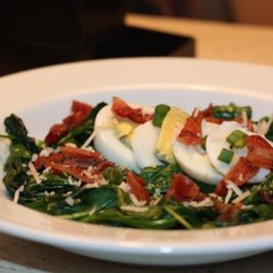 Easy Warm Spinach Salad Recipe - Warm spinach salad, including spinach tossed with bacon and hard-boiled eggs in a vinaigrette dressing, is a quick and fancy meal for lunch or dinner.