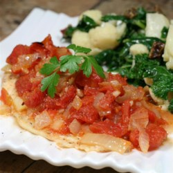 Oven Baked Swai Recipe - Swai fish is baked under a layer of tomatoes and onions in this quick and easy weeknight dinner recipe.