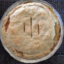 Green Tomato Pie IV Recipe -  For this delicious pie, green tomatoes are sliced, sweetened and spiced, and poured into a deep-dish, pastry-lined pie plate. The top crust is crimped on, and this robust pie is slipped into the oven.