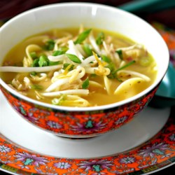 Chicken Noodle Soup III Recipe - Egg noodles are topped with shredded chicken and bean sprouts, bathed in hot chicken broth, drizzled with thinly sliced shallots cooked in oil and topped with green onion in this quick Asian soup.