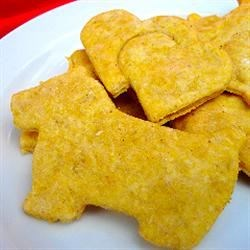 Peanut Butter and Pumpkin Dog Treats Recipe - Save money and concern for what you're giving your dog by making these dog treats using canned pumpkin, peanut butter, cinnamon, and whole wheat flour.