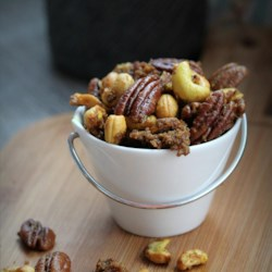 Sweet and Spicy Nuts Recipe - The first time I made this I had a small tub of raw nuts in my cabinet and didn't know what to do with them.  My mom gave me the recipe, and after I made it I couldn't stop eating them.  I am not a nut person, but I am totally addicted to these coated nuts. They're perfect for parties and festive occasions!