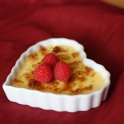 Creme Brulee I Recipe - Stovetop creme brulee with a brown sugar top, served over fruit -- use raspberries, or substitute your favorite seasonal fruit.