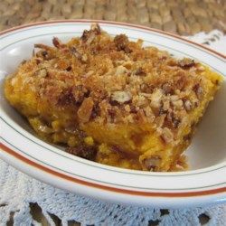 Sweet Potato Crunch Recipe - Sweet potato casserole gets an extra crunch thanks to pecans and coconut sprinkled into two layers for a Thanksgiving treat.