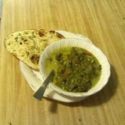 Kale and Spinach Saag Recipe - Fresh spinach and kale are cooked with ginger, garlic, and spices, then simmered with milk and cottage cheese to make a creamy dish to serve with hot cooked rice or naan.