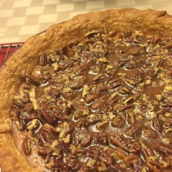 Sweet Potato Pecan Pie Recipe - For this luscious pie's filling, sweet potatoes are mashed and combined with egg, sugar, salt, cinnamon, ginger, cloves and cream. Pecans are combined with brown sugar and butter to make a rich caramelized topping that's spooned onto the cooked pie before it's slipped under the broiler for a moment or two.